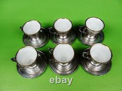 A set of six sterling silver demitasse or espresso coffee cups and saucers